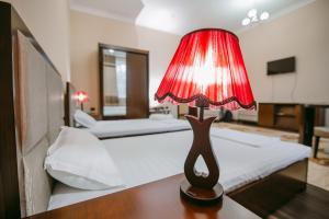 Кровать или кровати в номере Hotel Inju