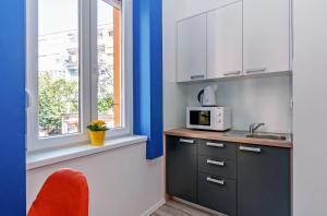 A kitchen or kitchenette at Sky Hostel