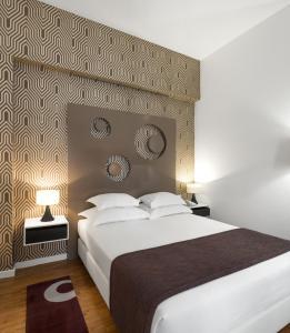 Hotel Tivoli Maputoにあるベッド