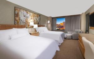 A bed or beds in a room at The Westin Las Vegas Hotel & Spa