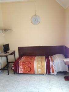 Un ou plusieurs lits dans un hébergement de l'établissement Hotel Rallye
