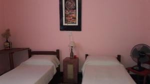 Una cama o camas en una habitación de Hostel La Rosa De Los Vientos