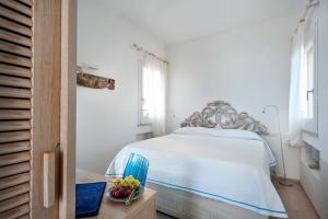 Letto o letti in una camera di Nido Del Pellegrino