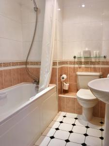 A bathroom at Best Western Aberavon Beach Hotel