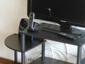 A television and/or entertainment center at Apartamento Infante T3