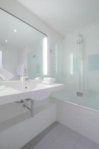 A bathroom at Agalia Hotel