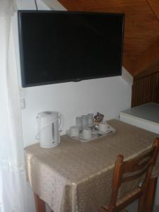 A television and/or entertainment center at Nicolas Rooms