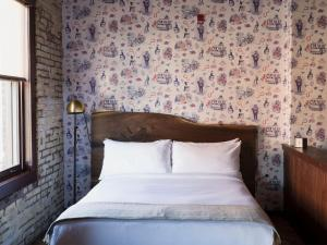 A bed or beds in a room at Wm. Mulherin's Sons Hotel
