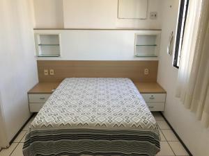 Cama ou camas em um quarto em Apartamento Meireles