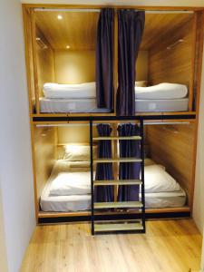 A bunk bed or bunk beds in a room at Meander Taipei Hostel - Ximending
