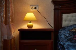 Кровать или кровати в номере Исторические Апартаменты в Центре