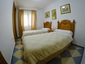 Cama o camas de una habitación en Apartamentos Niña de Oro