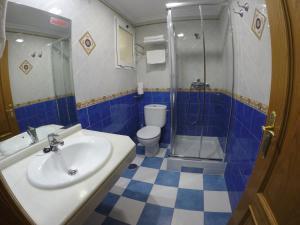 Un baño de Apartamentos Niña de Oro