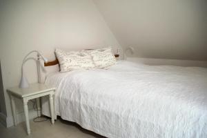 Ein Bett oder Betten in einem Zimmer der Unterkunft Suite im Huus