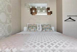 A bed or beds in a room at Квартира на Островского