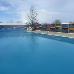 The swimming pool at or near Welcome Riverside Guesthouse