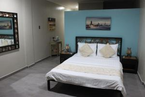 A bed or beds in a room at Linaw Beach Resort