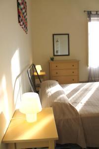 Letto o letti in una camera di Appartamenti Giunone