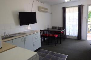 A television and/or entertainment center at Matildas End Holiday Units