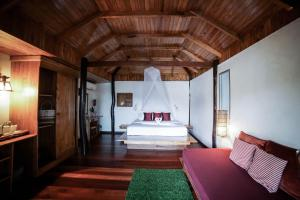 A bed or beds in a room at Cookies Salad Resort