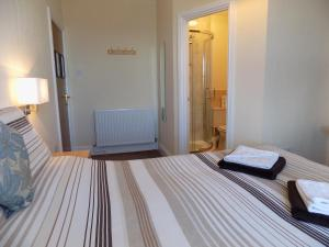 A bed or beds in a room at Belle View