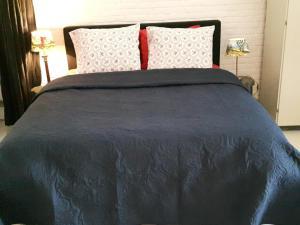 Een bed of bedden in een kamer bij De Gest
