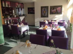 Ein Restaurant oder anderes Speiselokal in der Unterkunft Apart Hotel Gera