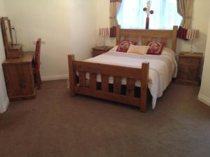 A bed or beds in a room at Crich Lane Farm