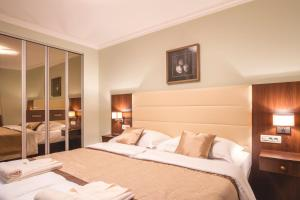 A bed or beds in a room at Luxury Apartments Villa Matea