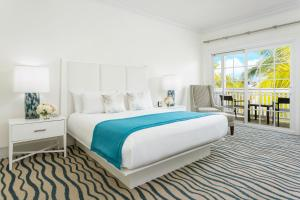 A bed or beds in a room at The Marker Waterfront Resort