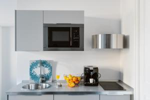 A kitchen or kitchenette at Dolac One Apartments