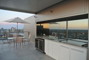 A kitchen or kitchenette at VUE Penthouse on King William