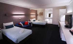 A bed or beds in a room at Mayfair Motel