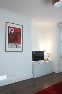 A television and/or entertainment centre at West Hill Apartment
