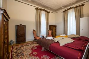 A bed or beds in a room at Le Saline Luxury Guest House