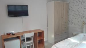 A television and/or entertainment center at Royaltybed Copenhagen