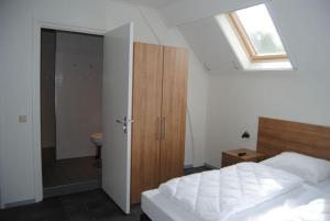 Ein Bett oder Betten in einem Zimmer der Unterkunft Duinoord Oostkapelle