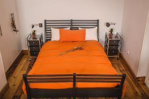 Cama o camas de una habitación en Apartamentos Teatro Romano