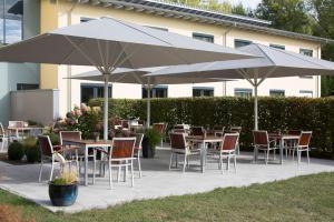 Ein Restaurant oder anderes Speiselokal in der Unterkunft Stadthotel Crailsheim