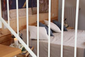 Ein Bett oder Betten in einem Zimmer der Unterkunft Albergo Ristorante Cavaliere