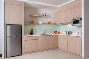 A kitchen or kitchenette at Citadines Rasuna Jakarta