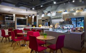 A restaurant or other place to eat at Park Inn by Radisson Residence Riga Barona