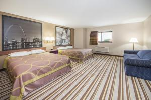 A bed or beds in a room at Super 8 by Wyndham Nevada