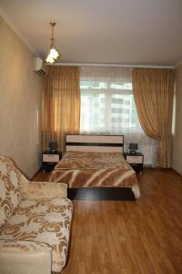 Кровать или кровати в номере Apartment at Gorkogo
