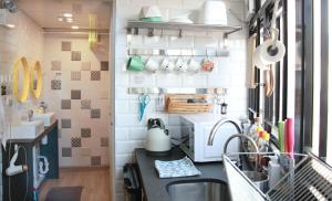 A kitchen or kitchenette at Moment Hostel