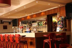 The lounge or bar area at Abbotsford Hotel
