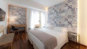 Ein Bett oder Betten in einem Zimmer der Unterkunft Vincci Soma