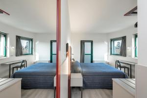 A bed or beds in a room at Hotel Porta Palio