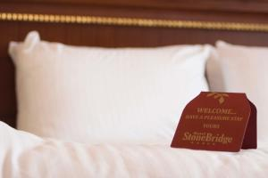 A bed or beds in a room at Stone Bridge Hotel