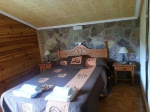 Cama o camas de una habitación en Hostal Rural La Collada de Aralla